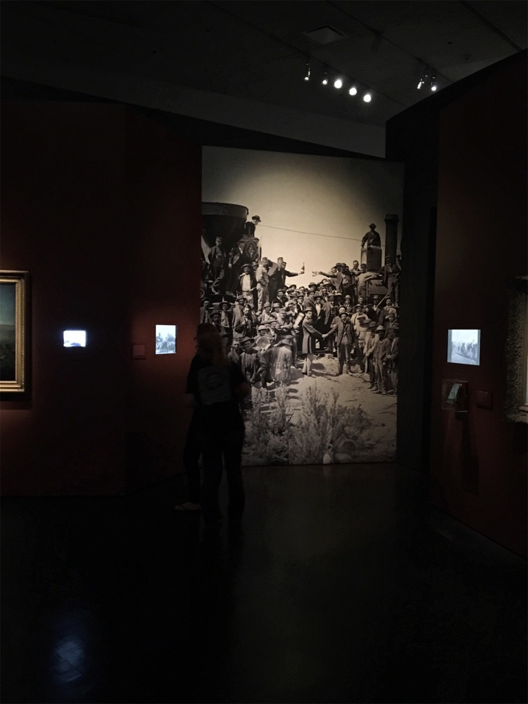 The celebratory image taken upon the completion of the Transcontinental Railroad. This photo also shows how prolific the use of film/media was in the exhibit.