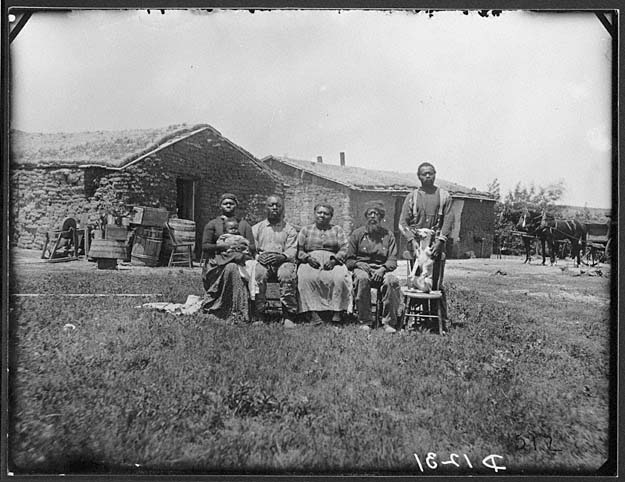 The Shores family, near Westerville, Custer County, Nebraska, 1887. Jerry Shores was one of a number of former slaves to settle in Custer County. He took a claim adjacent to that of his brothers, Moses Speese and Henry Webb (each had taken the name of his former owner). Photo from Solomon D. Butcher - Photographs of the Nebraska Homestead Experience, Nebraska State Historical Society.