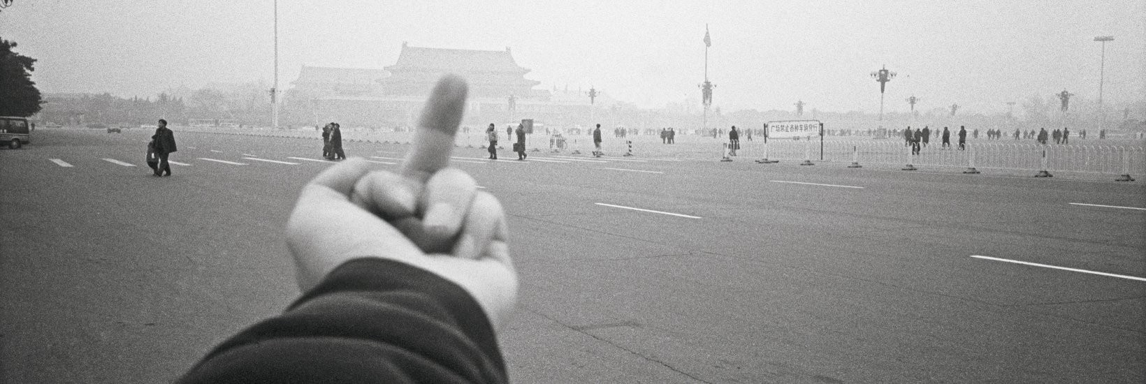A work from Ai Weiwei's  Study in Perspective  series, taken between 1995 and 2003. The artist travels around the world flipping the bird to different symbols of power.