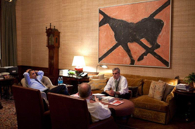 President Obama and staff sitting underneath  Butterfly by Susan Rothenberg