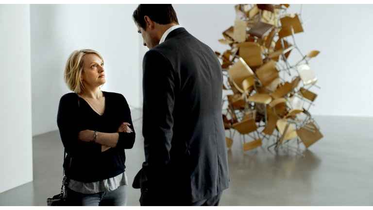 Chaes Bang plays Christian in  The Square . Christian is the chief curator at the Swedish contemporary art museum X-Royal. Elisabeth Moss plays a reporter who's reporting on the museum.