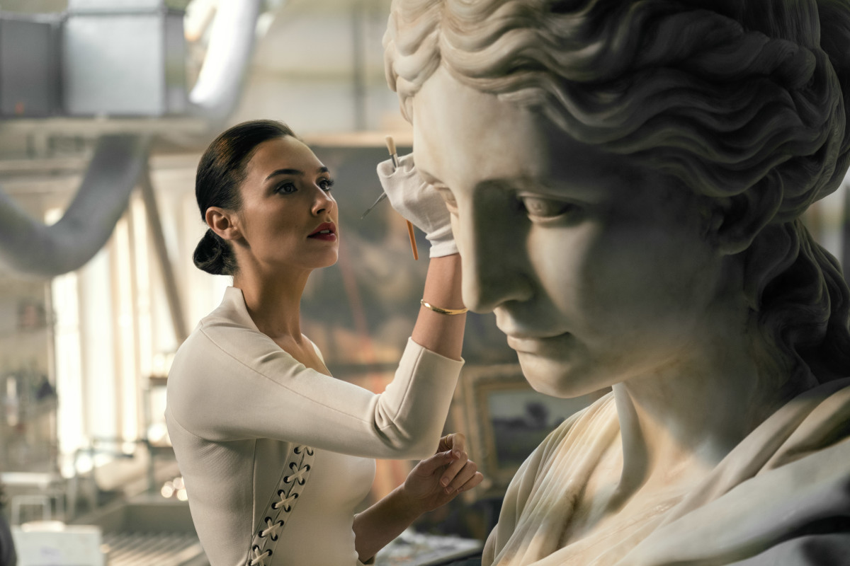 In  Justice League , Gal Gadot returns as Diana Prince who has taken on the additional role of conservator! Here we see her delicately cleaning a giant statue of... Diana!?
