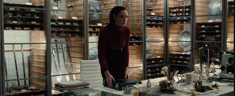 The blockbuster film  Wonder Woman  ends with the surprising revelation that Diana Prince (aka Gal Gadot) works at the Louvre Museum in Paris. We can't tell if she's a curator, researcher, or conservator in this film.