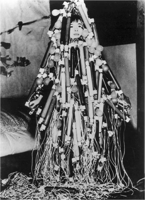 Atsuko Tanaka,  Electric Dress , 1956 (photo of Tanaka in the dress)