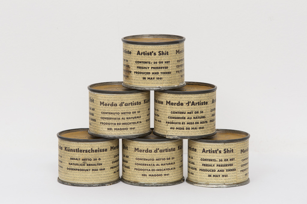 Piero Manzoni,  Merda d'artista  (Artist's Shit), n. 20, 53, 68, 78, 80, 1961, tin can and printed paper.