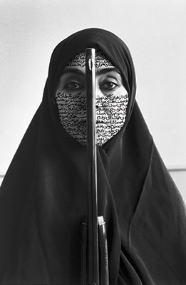 "Shirin Neshat,  Rebellious Silence , Women of Allah series, 1994, B&W RC print & ink, photo by Cynthia Preston ©Shirin Neshat (courtesy Barbara Gladstone Gallery, New York and Brussel)The  Women of Allah  series confronts this ""paradoxical reality"" through a haunting suite of black-and-white images. Each contains a set of four symbols that are associated with Western representations of the Muslim world: the veil, the gun, the text and the gaze."