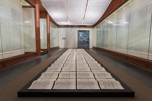 Xu Bing,  Book from the Sky , c. 1987-91, hand-printed books and ceiling and wall scrolls printed from wood letterpress type; ink on paper, each book, open: 18 1/8 × 20 inches / 46 × 51 cm; each of three ceiling scrolls 38 inches × c. 114 feet 9-7/8 inches / 96.5 × 3500 cm; each wall scroll 9 feet 2-1/4 inches × 39-3/8 inches / 280 × 100 cm (installation at the Metropolitan Museum of Art, 2014)
