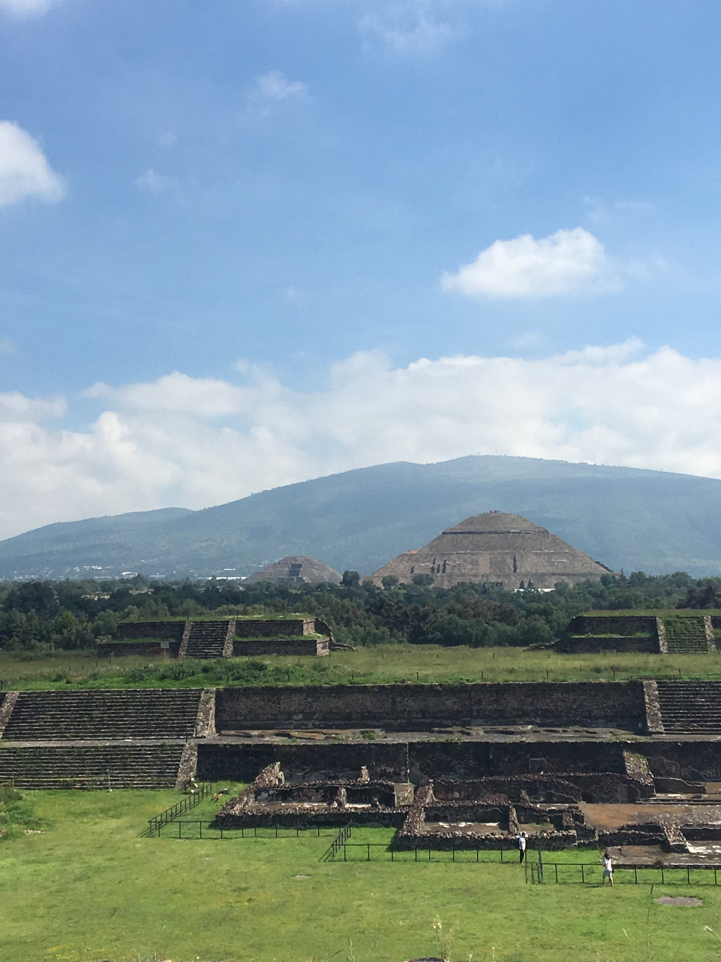 The view of the Pyramid of the Moon (center) and Pyramid of the Sun (right) from the Temple of the Feathered Serpent