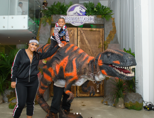 The birthday boy and his mother next to our realistic T-Rex Performer