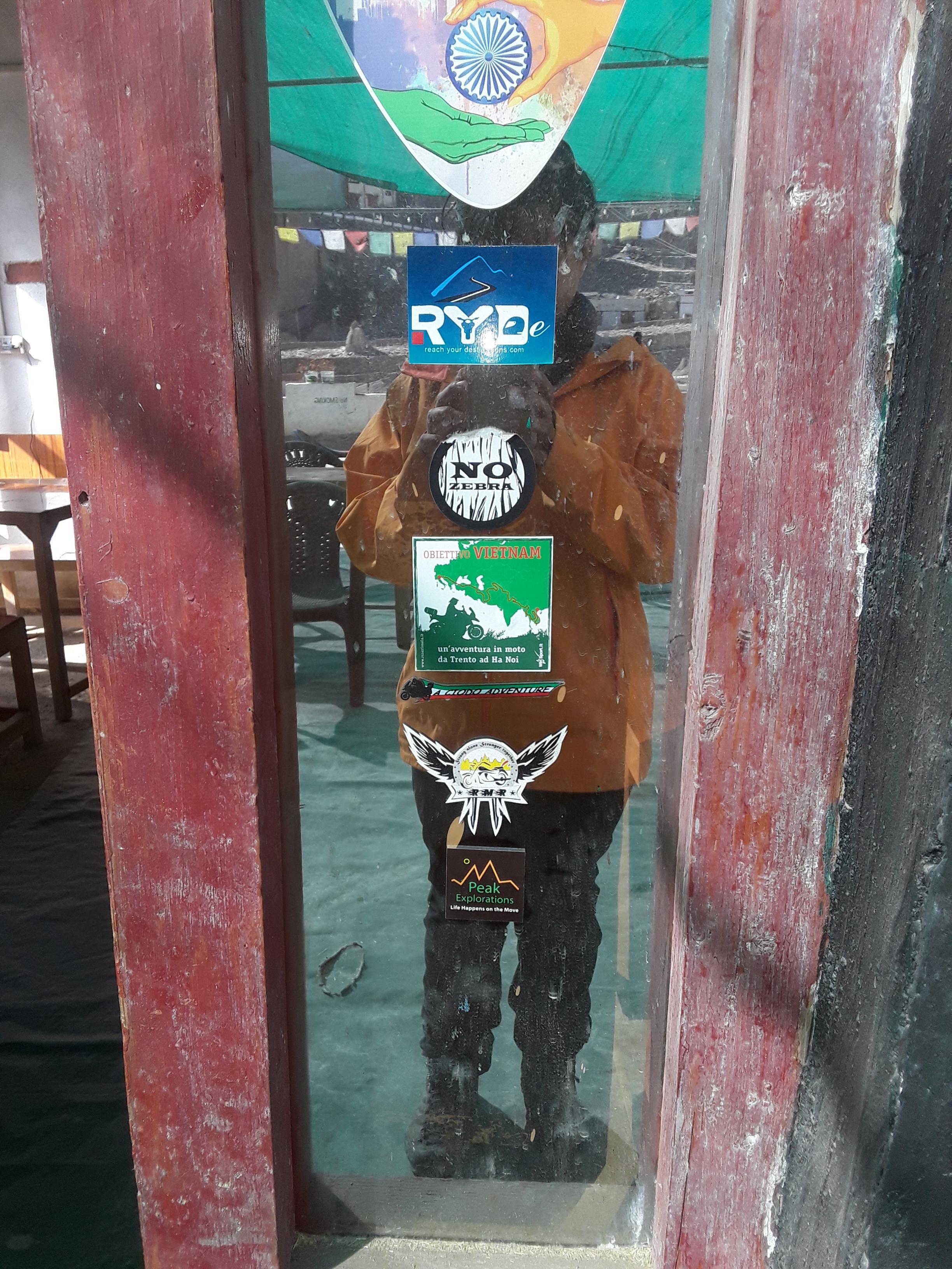 PEAK EXPLORATIONS - my social enterprise has been added to the slew of stickers in Lamayuru.