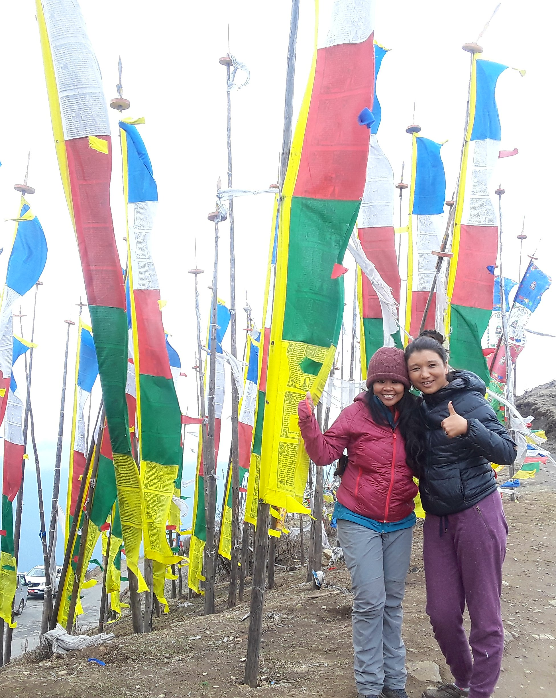 Dawa and I checking out the highest motorable pass in Bhutan, Chele La.