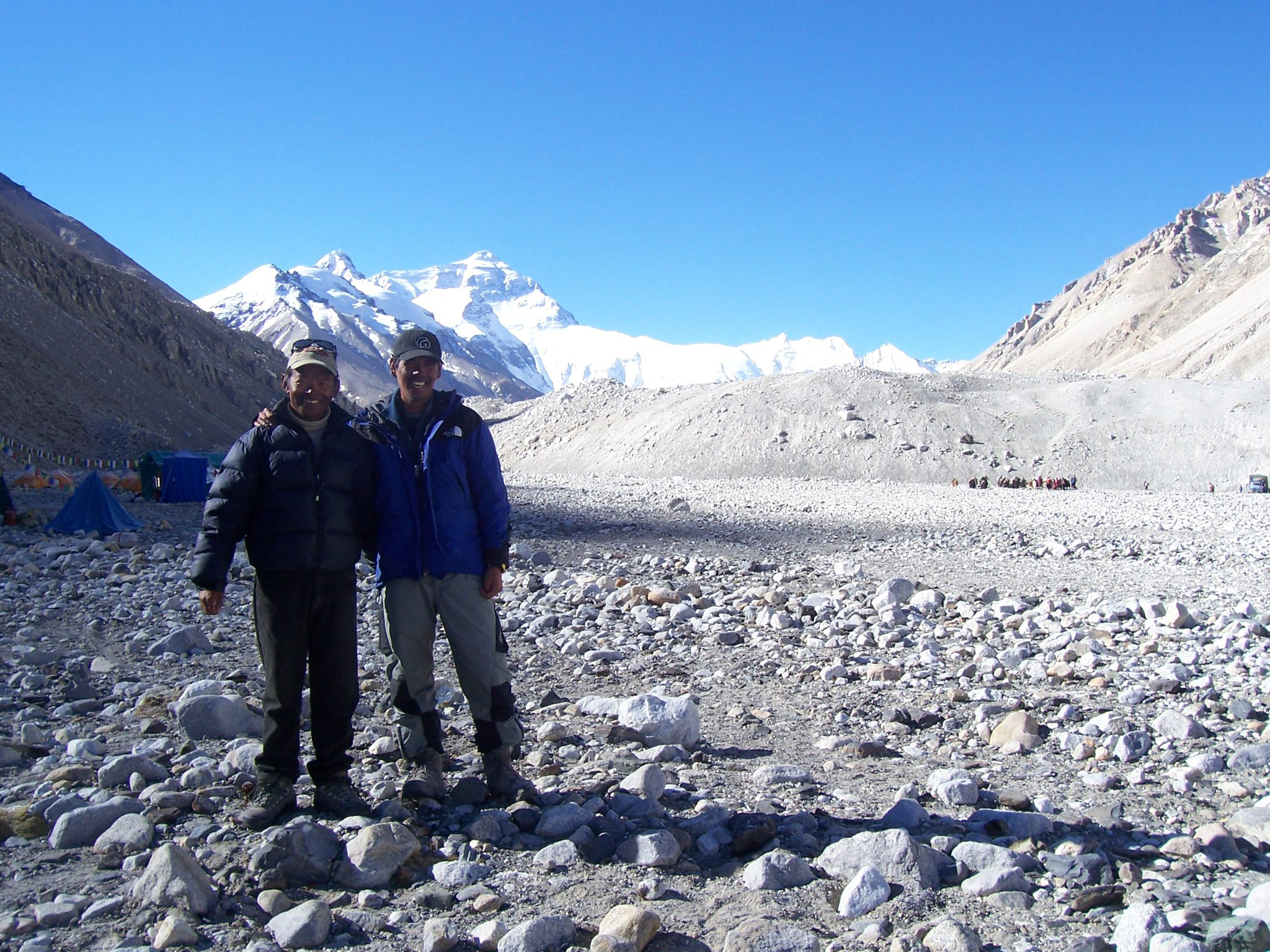Regie with his climbing Sherpa partner after a successful summit of Everest in Tibet.