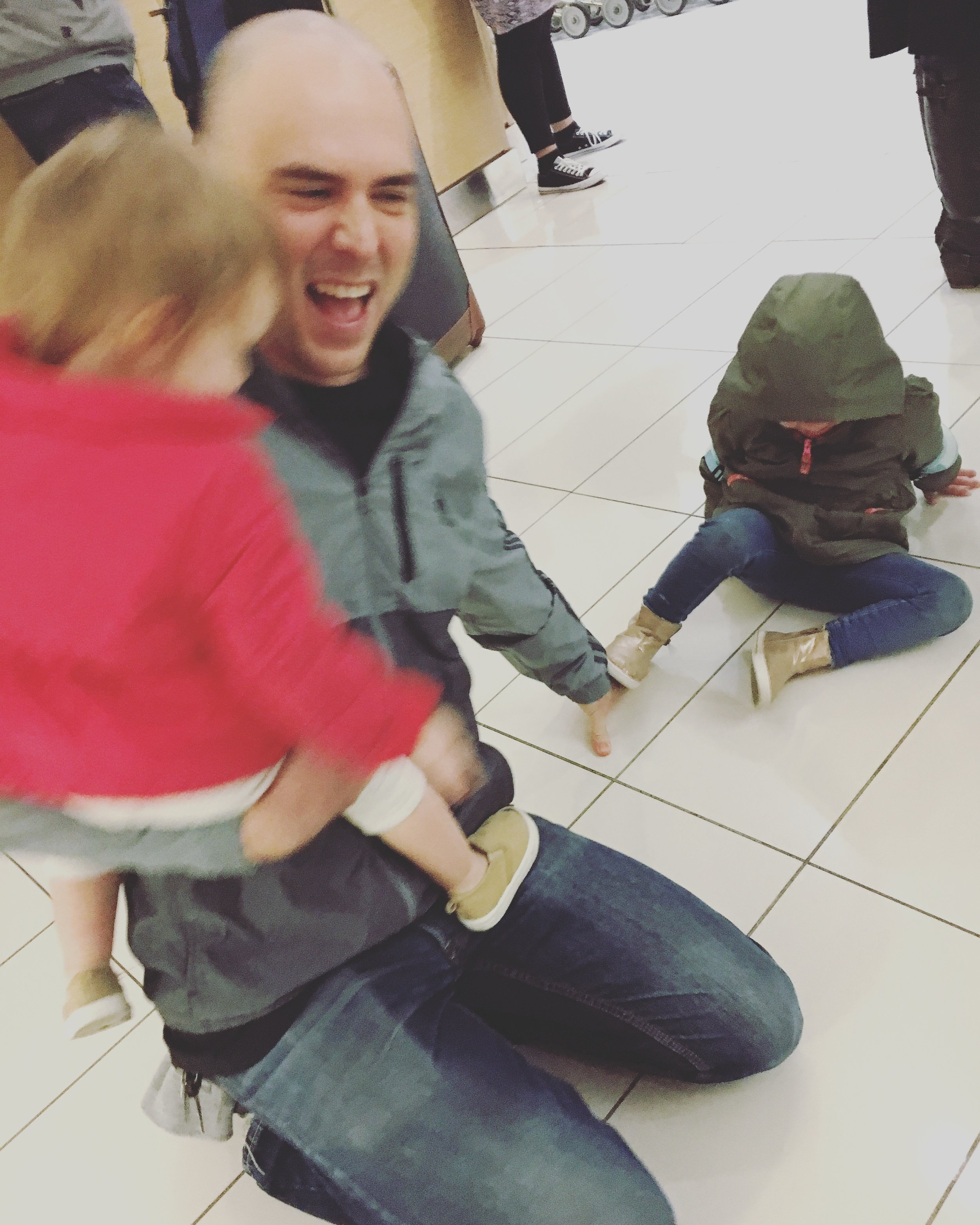 first time seeing Dad after a few weeks -- the girls tackled him right in the middle of the airport