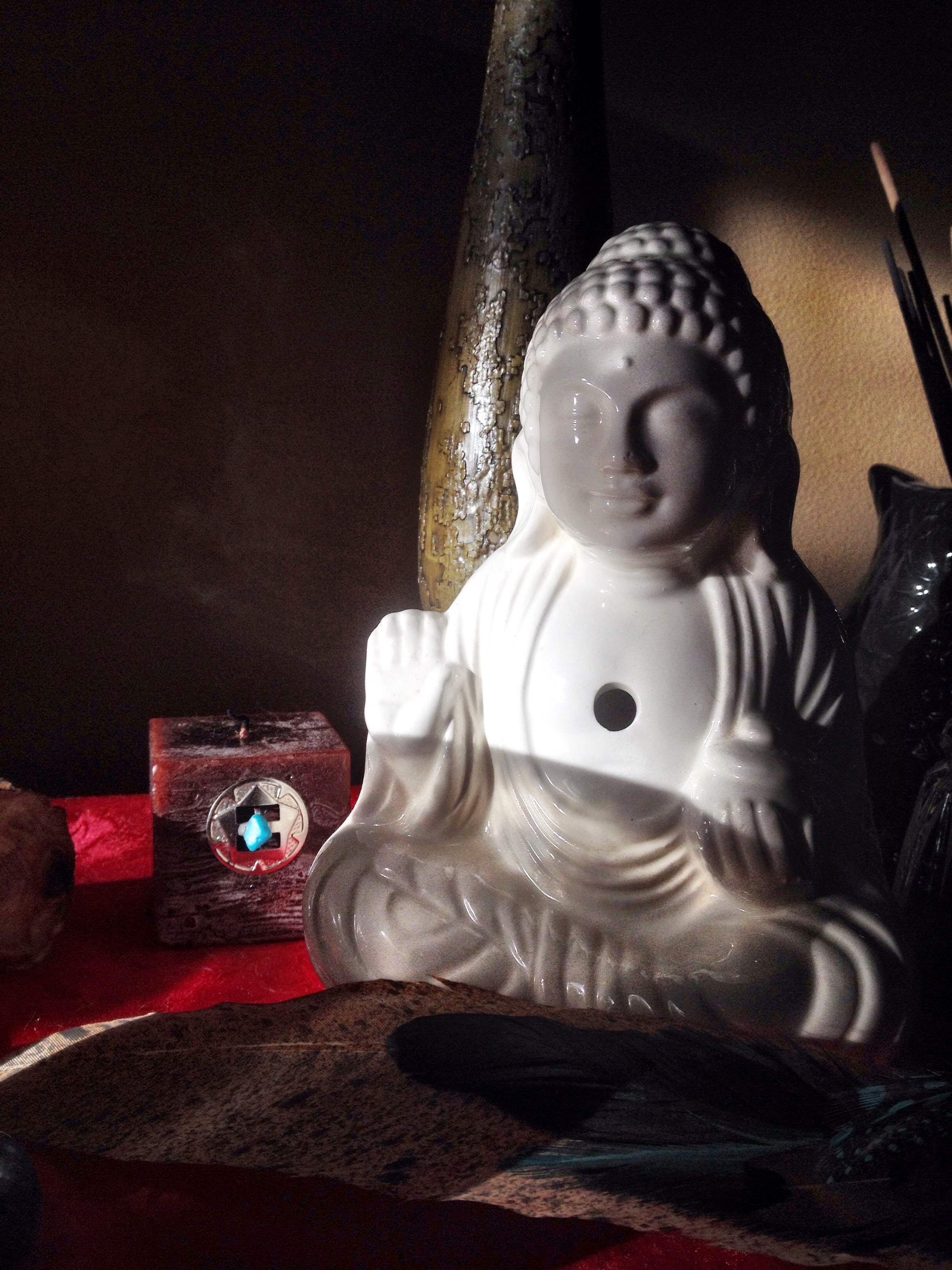 The Buddha on my altar is a reminder of peace, compassion, and wisdom.