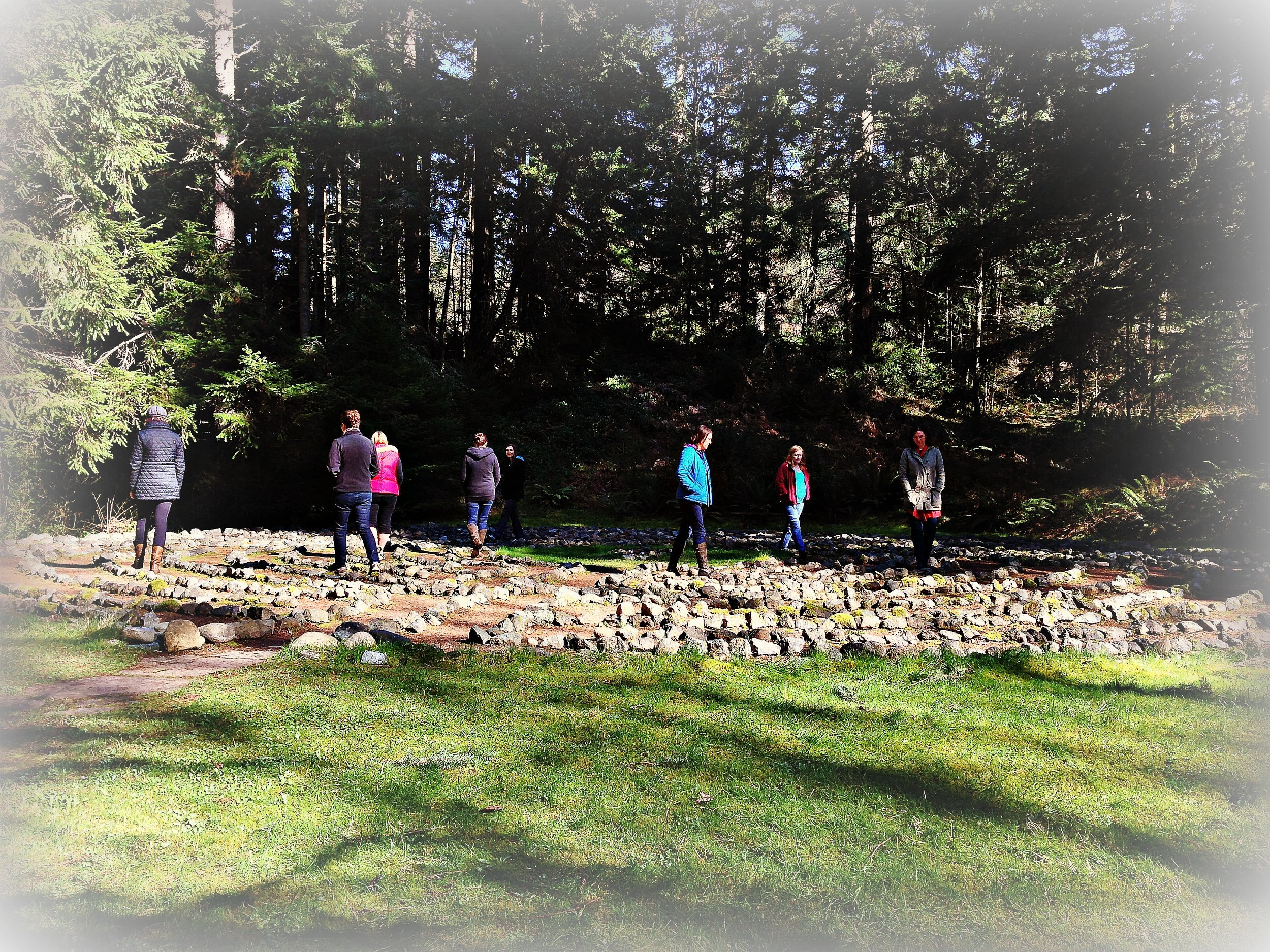 A group of women walking the labyrinth at The Whidbey Institute on Whidbey Island, WA