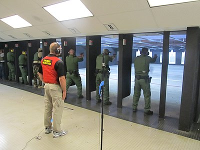400px-Federal_law_enforcement_officers_during_firearms_training_exercises_at_indoor_firing_range.jpg