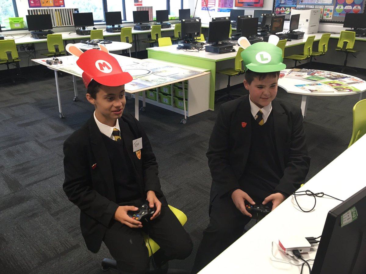 """Digital Leaders taking a break playing Mario Kart with their hats on. Team Luigi or Team Mario? Vote now!!"""