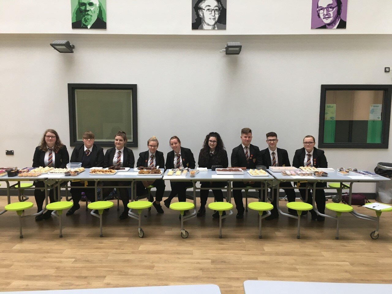 The senior prefect team selling cakes, biscuits, and doughnuts in support of Macmillan Coffee Morning 2019, they raised £135 in total. Da Iawn!  #StriveBelieveAchieve