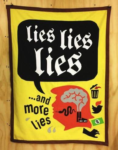 "Stephanie Syjuco's banner ""Lies Lies Lies.""   A Cheeto-orange Trump spouts garbage, tweets, money, and a pussy-grabbing hand."