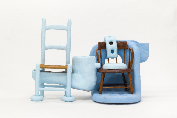 "Thomas Barger, ""Love Me, Protect Me Chair"" (2018), paper pulp, plywood, two wooden chairs, polyurethane, and paint"