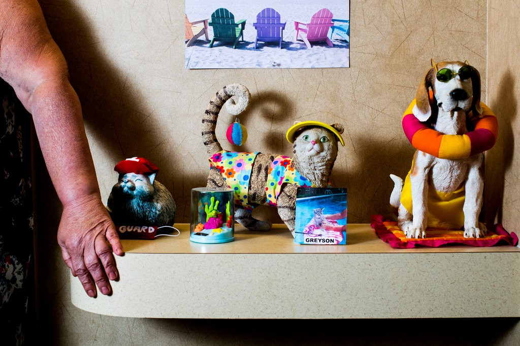 The shelf outside Jackie Amadeo's apartment at Brooksby Village. Photo Adam Glanzman for  The New York Times.