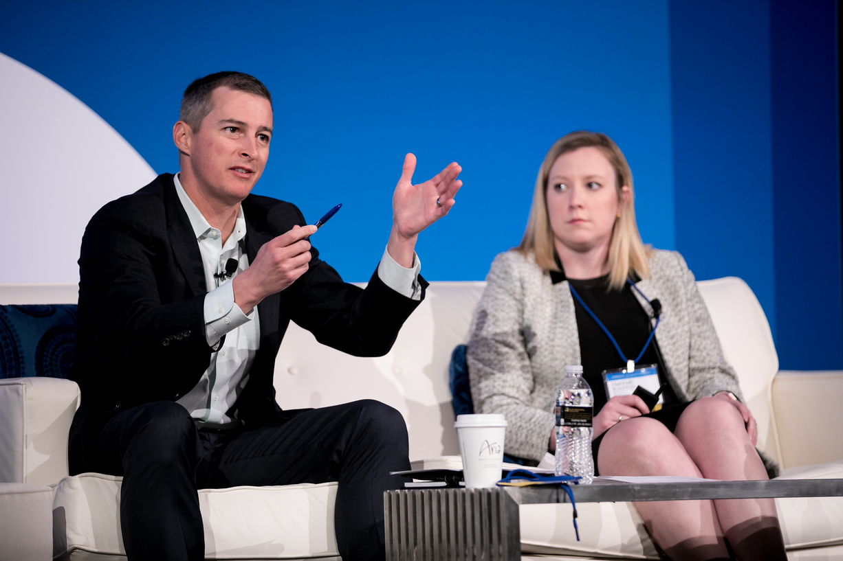 "Justin Anderson (left) and Hannah Buschbom (right) presenting ""BUILDING CENTERS OF INFLUENCE and Creating a Collaborative Network for Female Leaders"" at Barron's Top Advisory Teams Summit in Las Vegas, NV. Photo Credit:  LILA PHOTO"