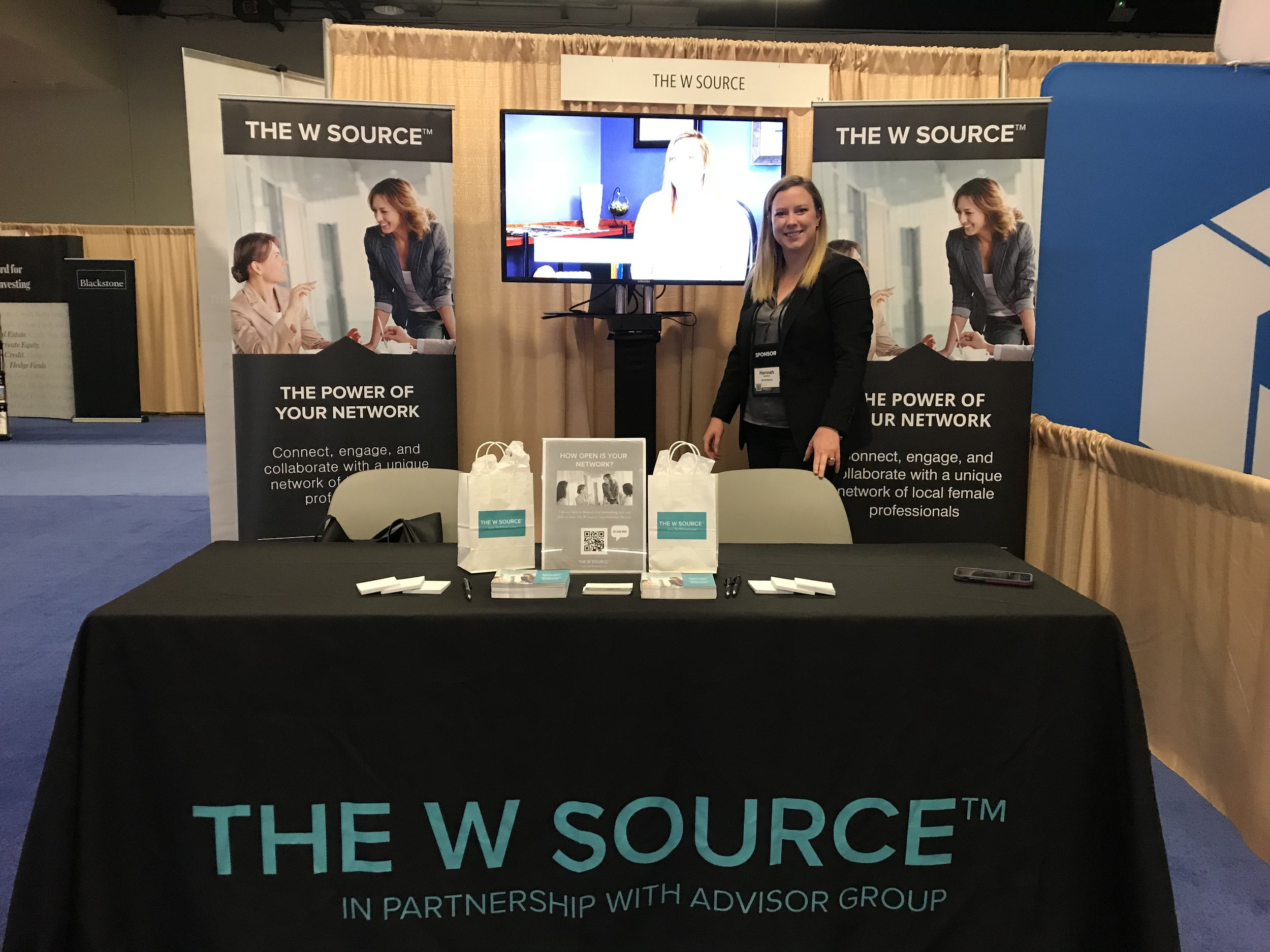 Cofounder of The W Source™ at The W Source™ booth ready to greet Advisor Group ConnectEd attendees.