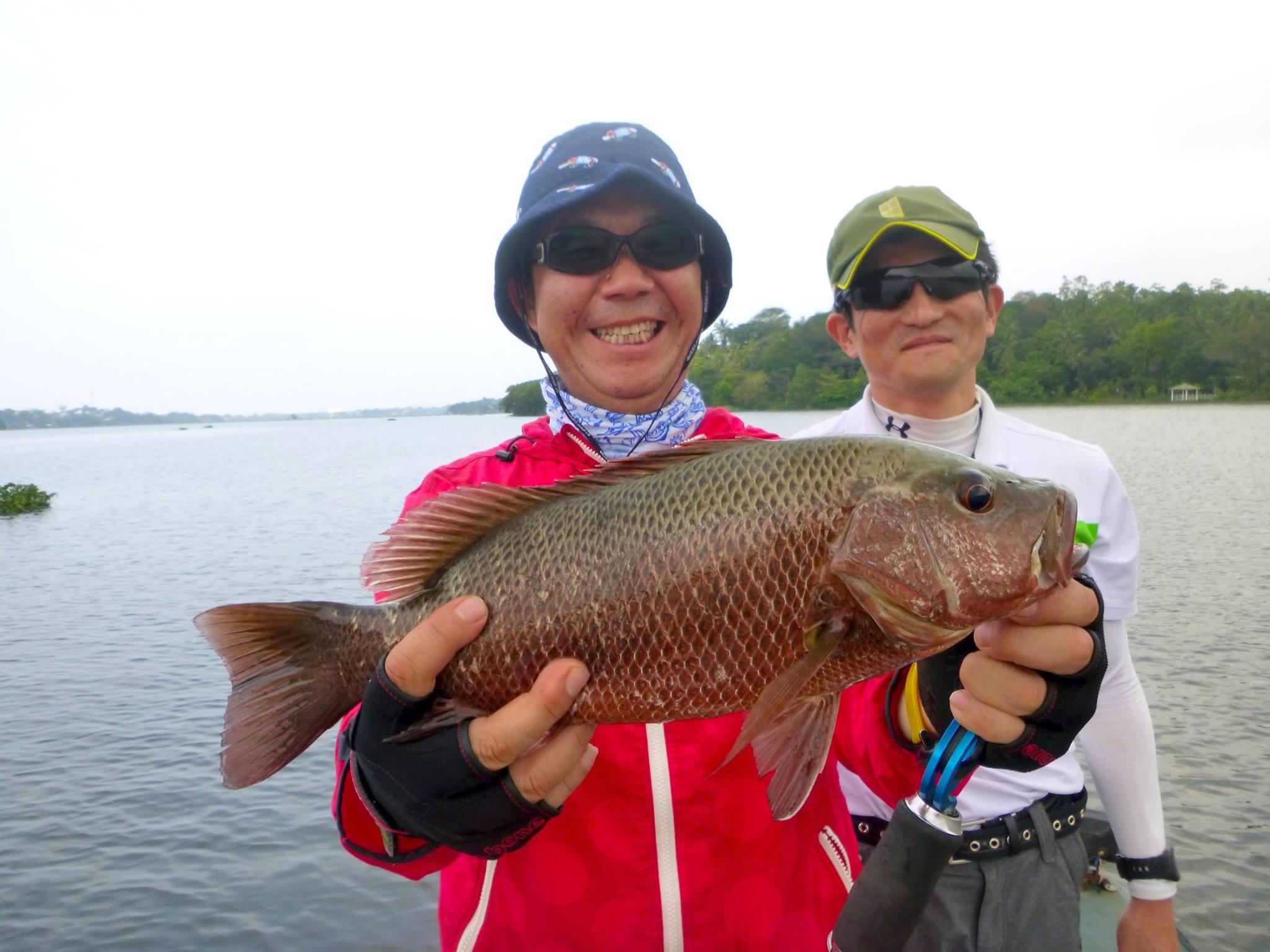 Japanese Angler Fishing Bolgoda Lake Sri Lanka.jpg