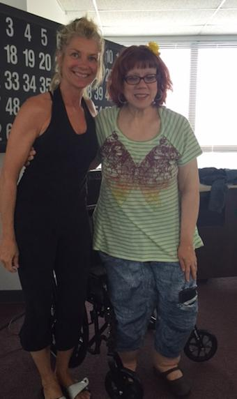 Y4C instructor Christina stands with Anita who has used the classes to strengthen her body.