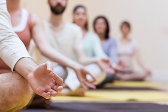 group-of-people-doing-meditation-on-exercise-mat_1170-226.jpg
