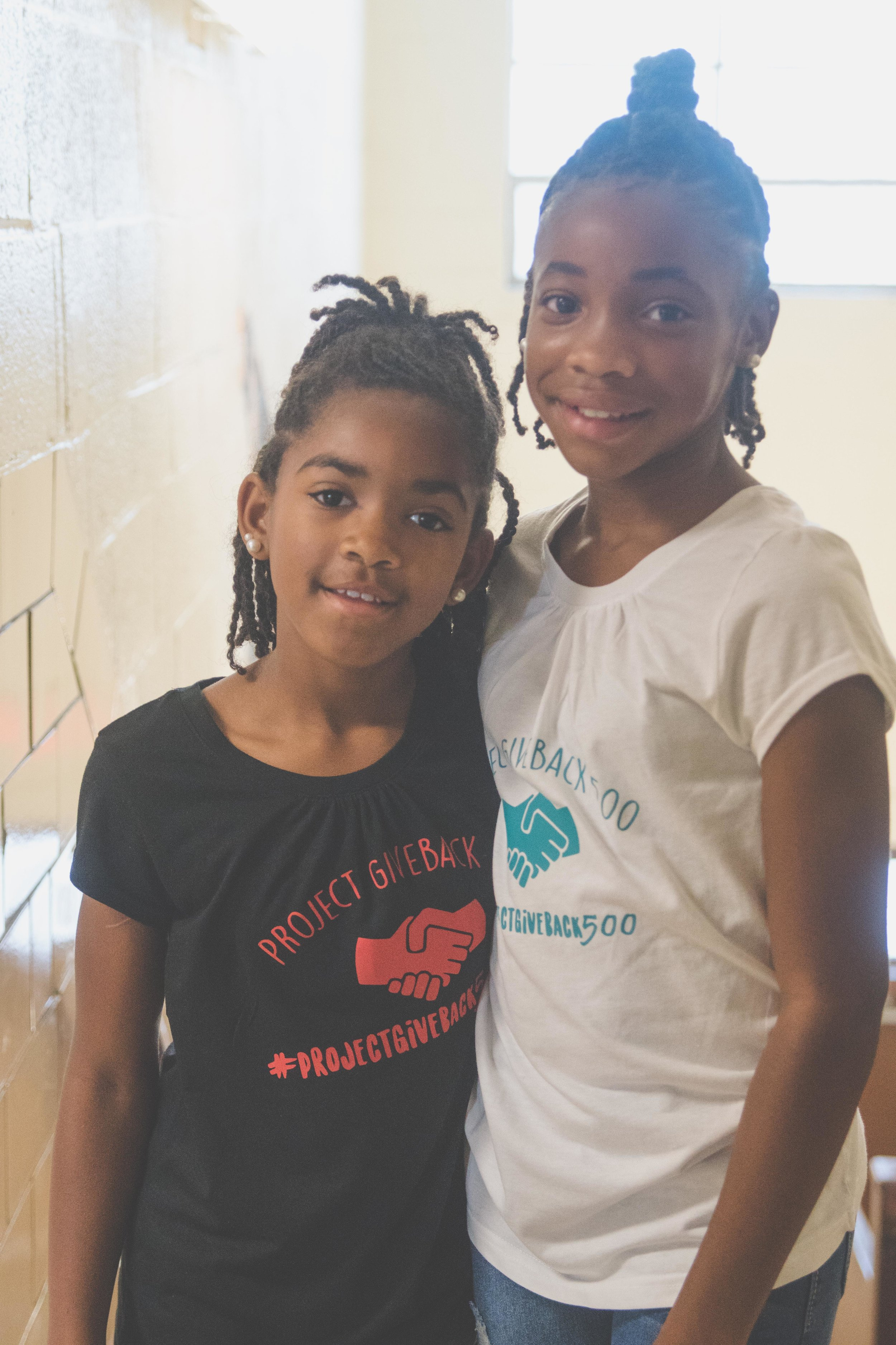 DaShai Morton with her younger sister helping for Project Give Back 500.
