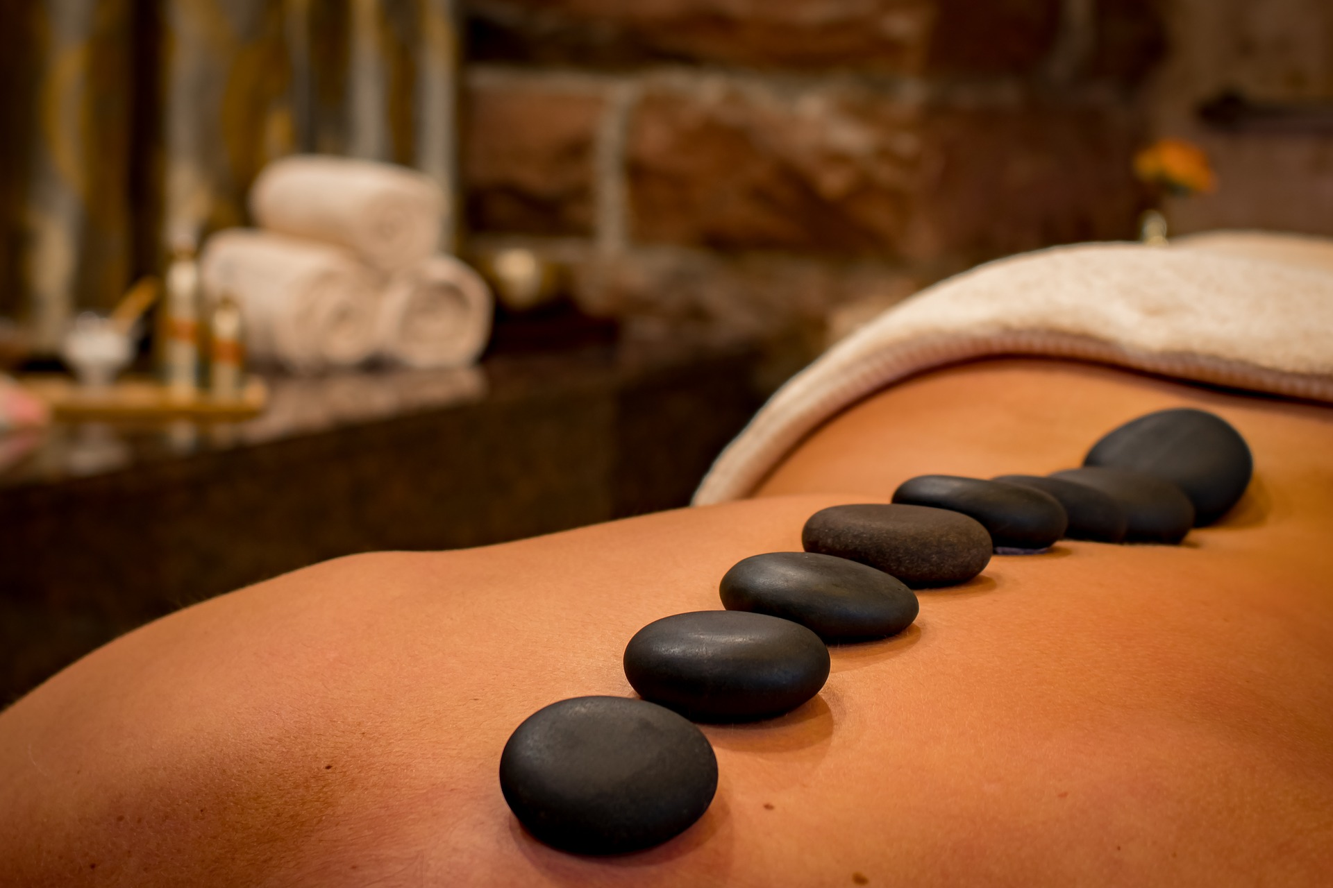 A woman getting a relaxing hot stone massage