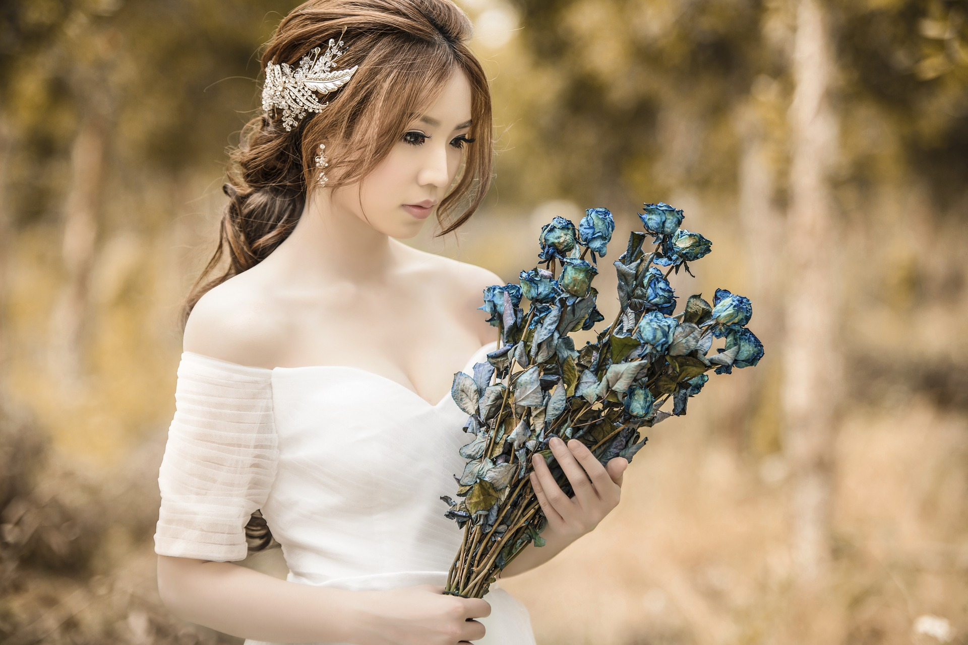 A bride looking at her bouquet