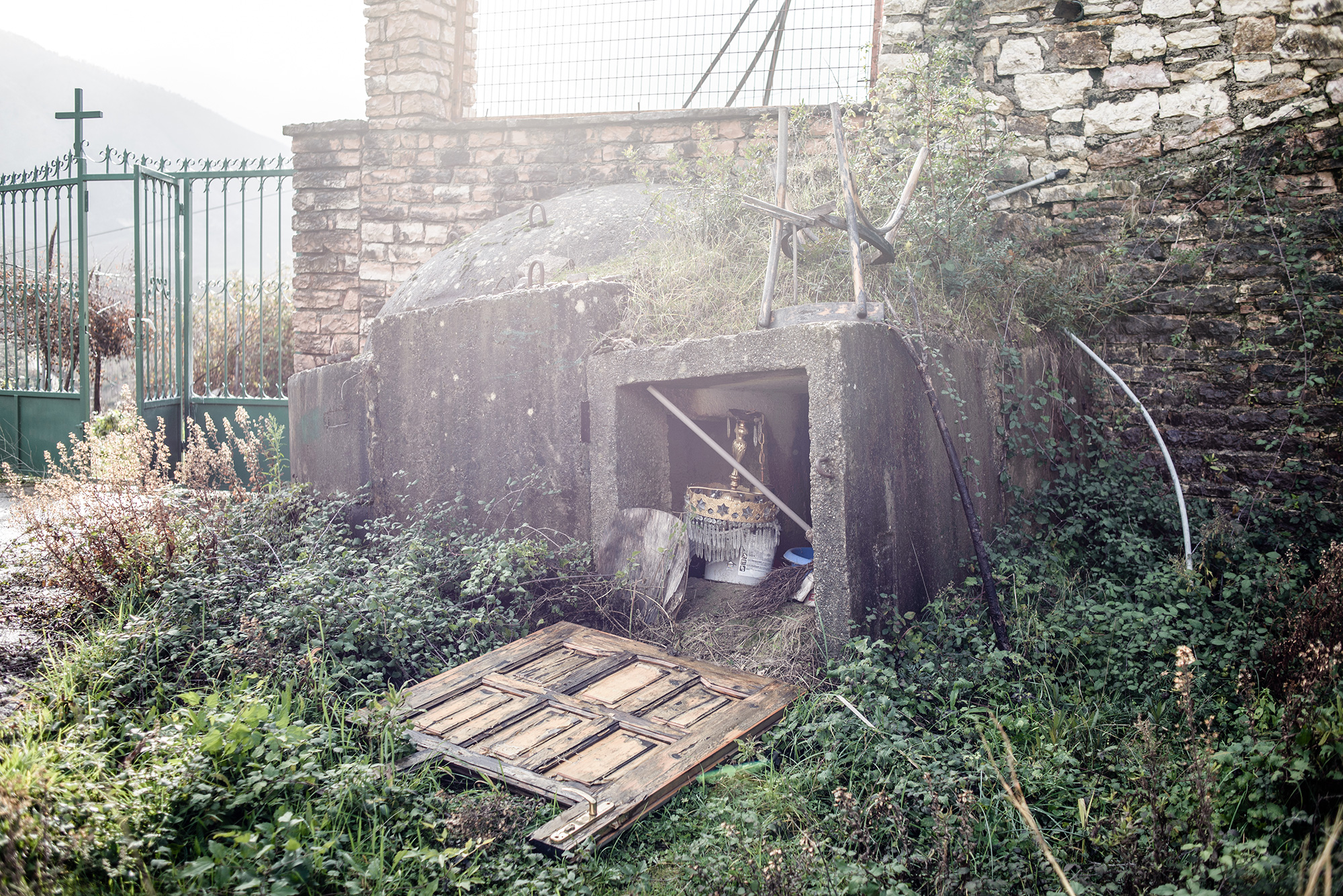A bunker is used to store church utensils in the churchyard, Bistrica, Albania