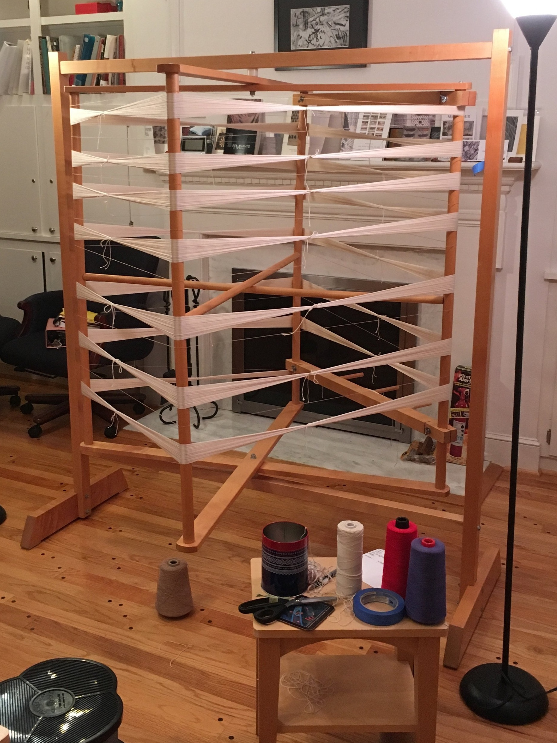 I use this to wind my warps. This holds up to 50 yards. This isn't my own studio set up- but is the best image I have for this wheel. Note the handy table nearby, the stool- the cool can for saving the ties.