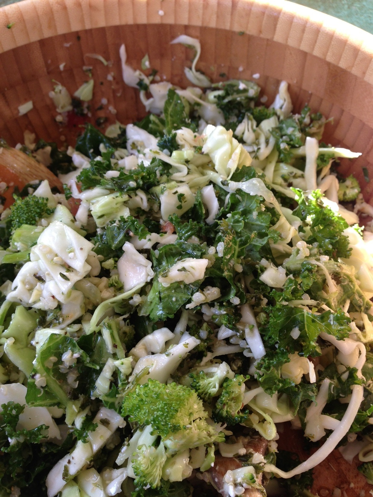 My friend Lisa sent me this picture last night. I was so happy to receive this and to know that my alkaline lifestyle is rubbing off on my fiends. So I thought I would post it and share this delicious salad with you. Eating alkaline does not have to be boring. Not only is this salad beautiful to look at, it's a crowd pleaser with great bursts of flavor in every bite.     Don't worry about the amount of ingredients, just use what you have to make a nice combination.   I have given you an idea of what to go on.     Serves 4     About 2 cups Kale, chopped  About 2 cups Cabbage, chopped  1 cup Broccoli florets    1 cup of cooked Quinoa  A handful of cherry Tomatoes, sliced in half  ½ cup Parsley, roughly chopped  ½ green onion, diced  A few mint leaves  Dressing:  3 Tbsp. olive oil   1 Tbsp. fresh lemon juice  ½ tsp. minced garlic or ¼ tsp. minced garlic  Salt and pepper to taste
