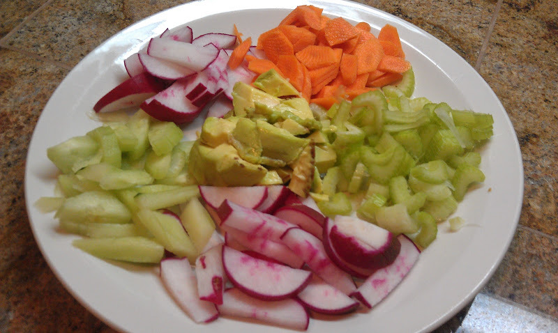 This is a composed salad that makes a great lunch or side dish.     1 cucumber  2 radishes  1 stalk celery  1 carrot  ½ avocado     Slice and dice up the vegetables. Arrange on a plate. Dress with a little Olive Oil and Tangerine juice.   Enjoy, it's so refreshing