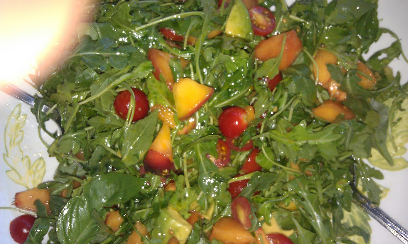 Arugula Salad    I went to a friends house and this salad was served.  Here is how we can make it more alkaline.      Approx. 4 cups of arugula  1 nectarine or peach  1 cup of cherry tomatoes, cut in half  1 cup sliced cucumber   1 avocado, diced  Dress with the juice of one lemon mixed with 3 tablespoons of olive oil.   Season to taste