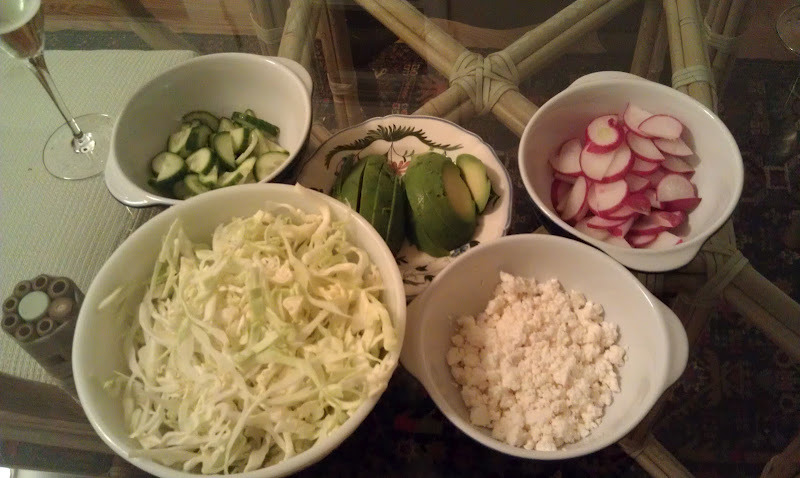 These are the side dishes that I serve with the enchiladas.   ½ cabbage sliced thin   1 cup queso fresca (fresh Mexican style cheese)   1 avocado, sliced   4 large radishes, sliced   1 cucumber, sliced   ½ cup cilantro, chopped