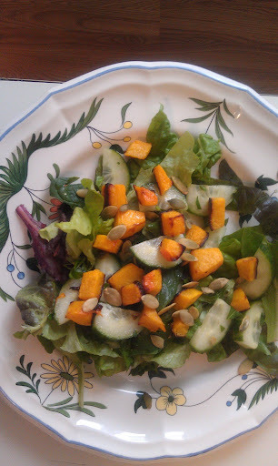 Bring Fall into your salad by adding roasted butternut squash. It adds a wonderful natural sweetness and a beautiful color.   For 2 servings   2 cups mixed greens   1 hot house cucumber, sliced   ½ of a small butternut squash, diced and roasted at 325 degrees for 20 minutes.   ½ cup pumpkin seeds   ½ cup chopped parsley   Juice of an orange or tangerine   1 Tbsp. Olive Oil    Arrange the lettuce on a platter , sprinkle with the parsley. Add the cucumber and squash. Sprinkle with the pumpkin seeds. Mix together the citrus juice and olive oil. Pour over the salad and toss. This is a very easy but beautiful presentation.   Note: If you are using tangerines, add a few segments to the salad for a little extra flavor punch.