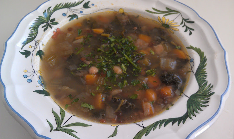 This lentil vegetable soup is wonderful to serve on a cold day. I have had it in my fridge all week and it has been my go to snack or meal.    2 Tbsp. Olive Oil    1 small onion chopped, approx 1 cup   2 stalks of celery chopped   2 carrots, chopped    ¾ cup lentils   2 cups kale chopped   1 turnip, chopped   1 cup cooked white beans   2 Tsp. sea salt   ½ cup chopped parsley    5-6 cups vegetable stock    In a large soup pot, heat the oil and add the onions. Cook about 5 minutes until they have softened. Add the celery, carrots, turnip and kale. Mix together. Add the beans.  Cover with the stock and simmer for 1 hour. To serve, Ladle into a cup or bowl and sprinkle the parsley on top.    Note:  I like to start with 5 cups of stock and get the soup cooking. I keep 1 cup on hand to add if the soup is coming out too thick. If you like a thicker soup, just use 5 cups of stock. For a thinner soup add more.