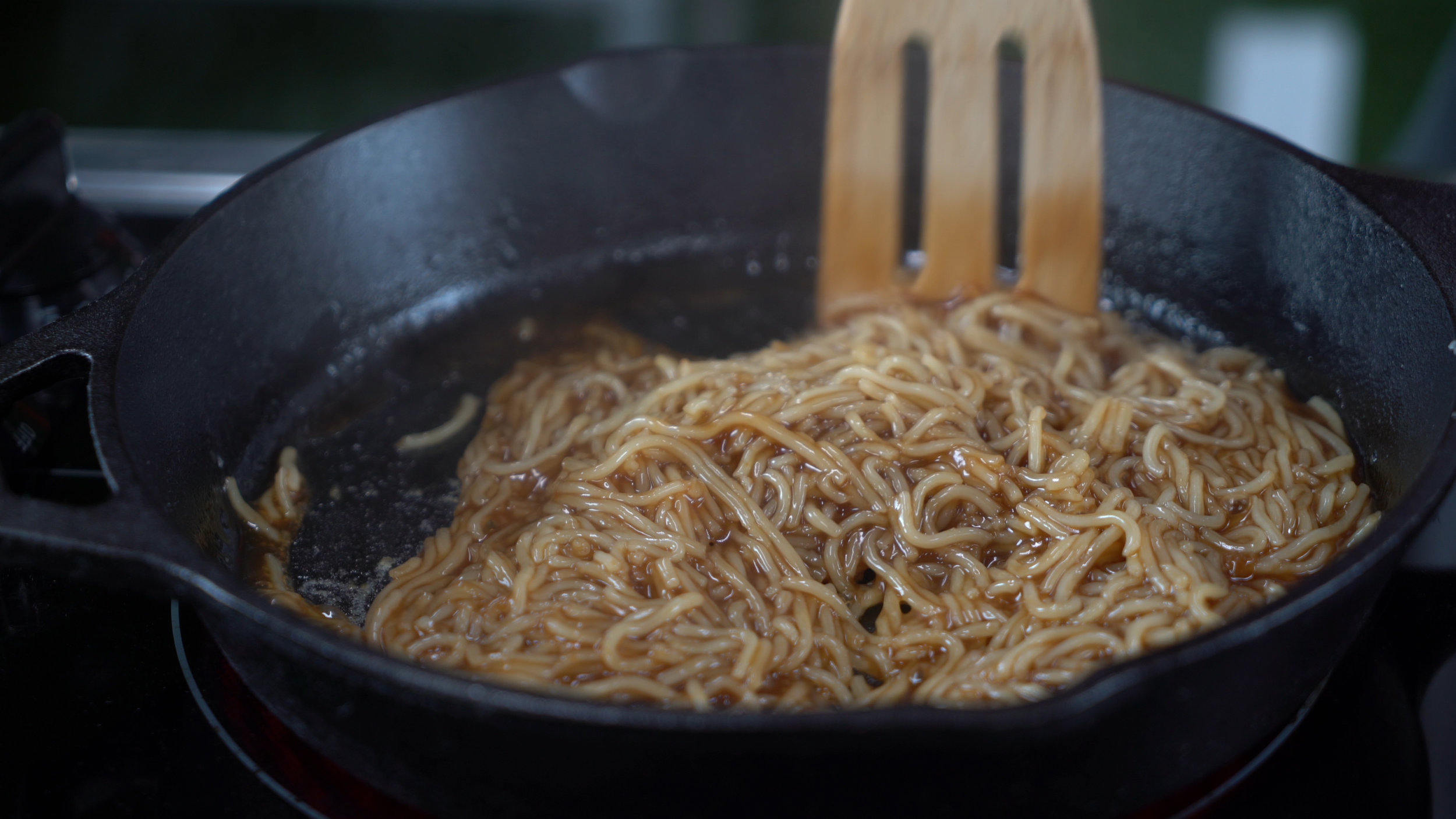 step 3. fry the noodles and combine with sauce