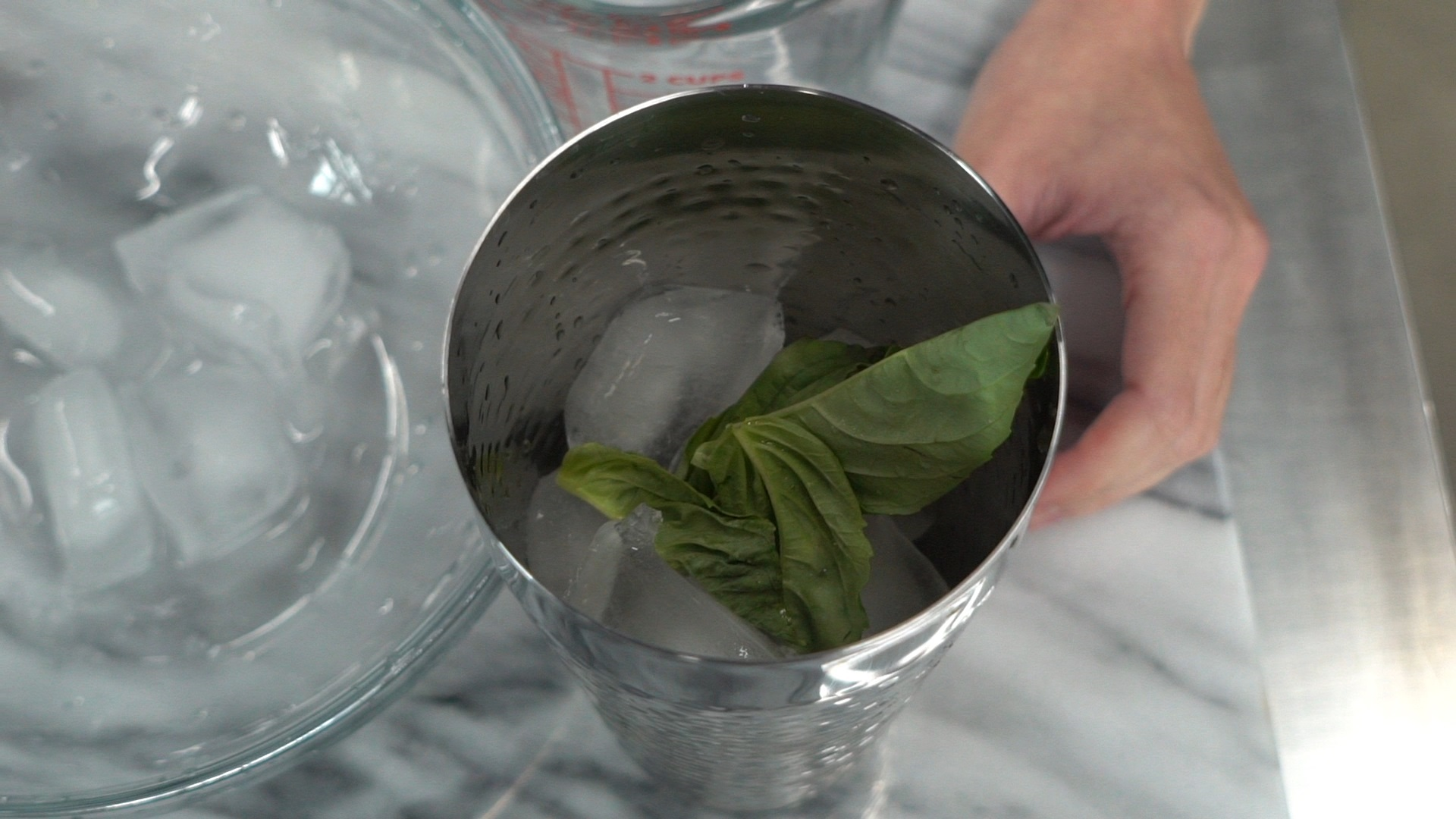 step 2 add 4 basil leaves