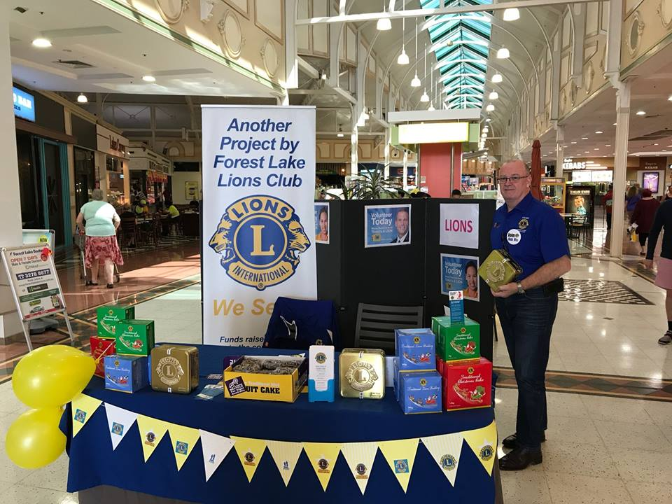 Lions Stuart Grierson selling cakes at the Forest Lake Shopping Centre.jpg