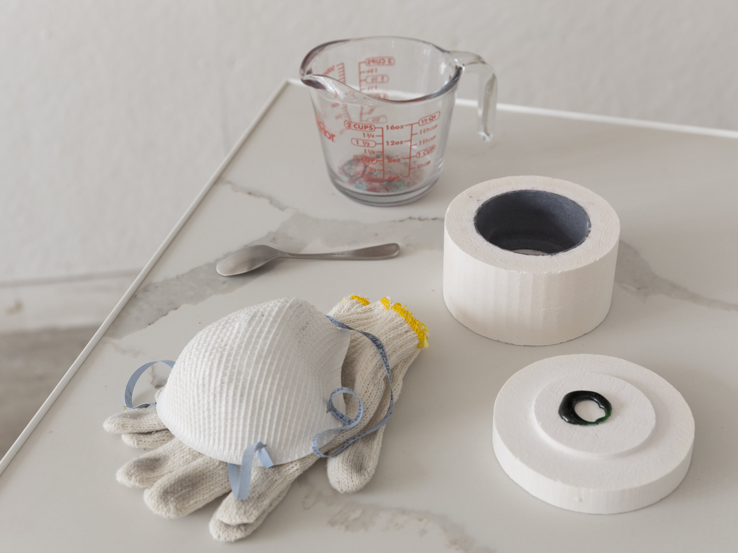 Station 3 detail: objects needed to create microwaveable chakra   Microwavable kiln, gloves, dust mask, measuring cup, glass shards, microwaved chakra, spoon ,  quartz, iron   Photo credit:  Jonathan Allen