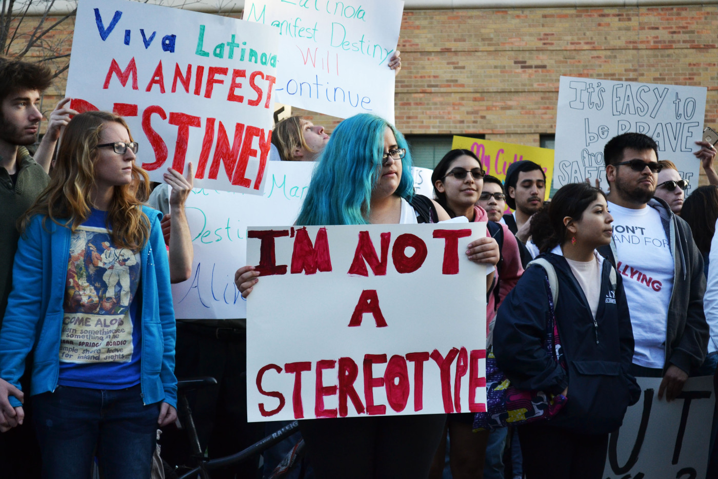 Nadia Flores, second year undeclared, stands in front of the Phi Gamma Delta (FIJI) fraternity house in Austin, Texas on February 12, 2015. She participated in the United Against Racism March in order to bring attention to University administrators that the party FIJI had affected her culture in a negative way.