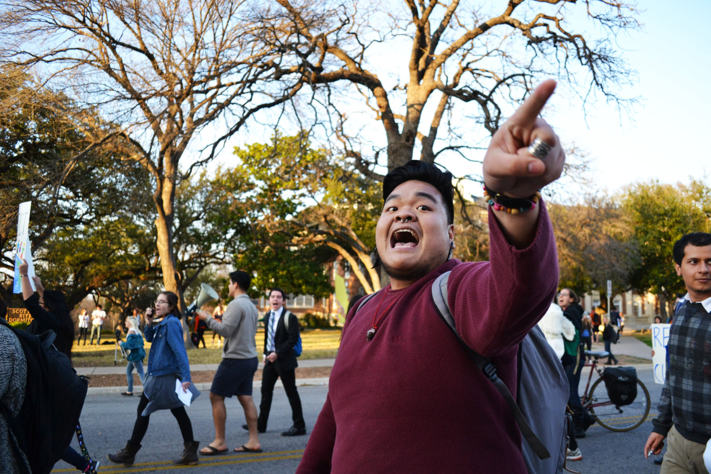 Philip Olalo, third year international relations, shouts back at an onlooker, who disagreed with the march, at the United Against Racist March on February 12, 2015 in Austin, Texas. Olalo felt rage when the onlooker shouted that the group did not deserve respect.