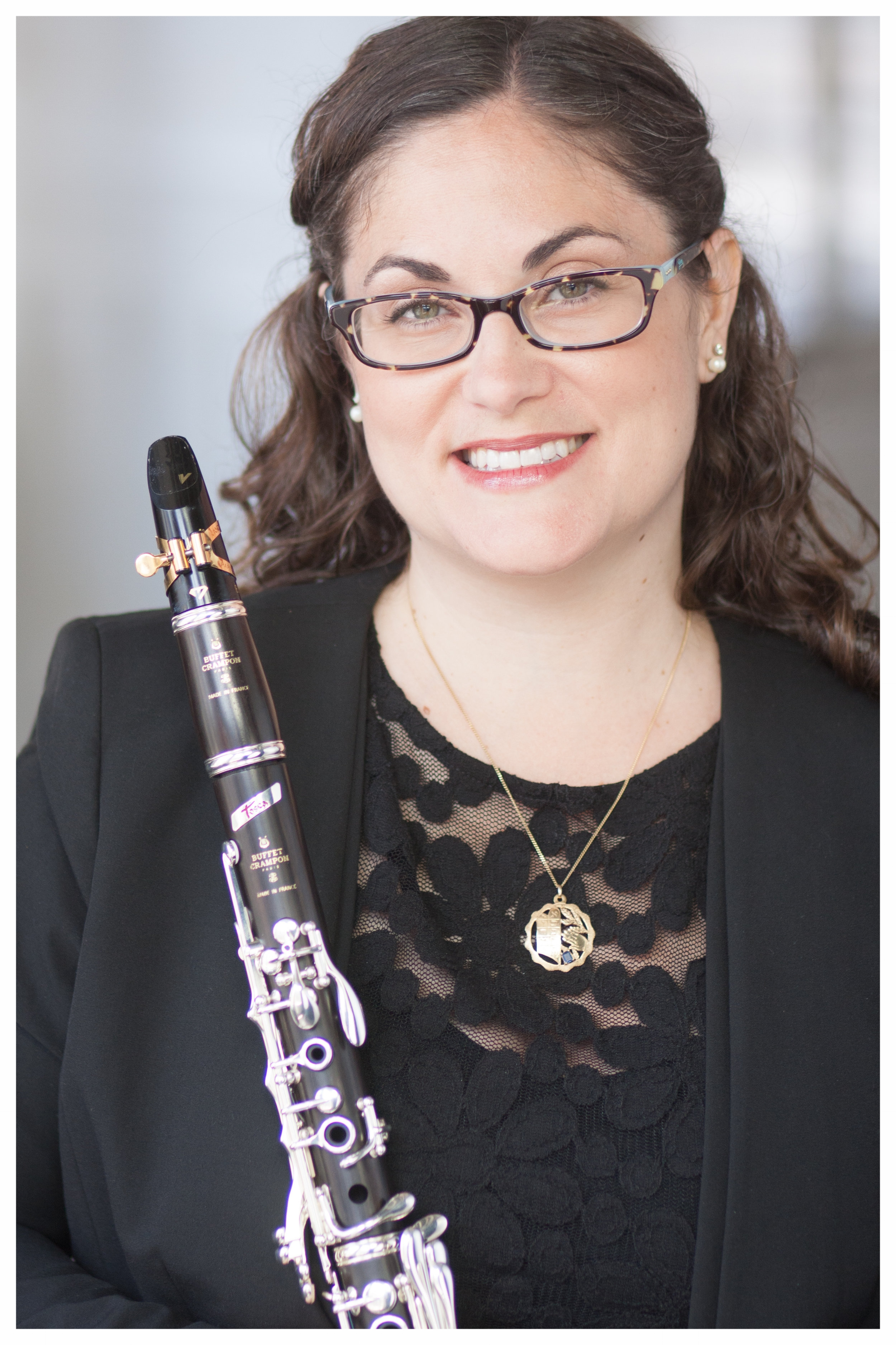 teaching - Throughout my professional career, I have developed a well-rounded curriculum for the aspiring clarinetist that is based on a combination of current best practices and my own experience as a musician. By focusing on the needs of each student with regard to tone production, embouchure, breathing, posture, tonguing, rhythm, sight reading, and performance anxiety, I have been able to help them dramatically improve their technique.I have found that students usually fall into three categories: students that learn best through critical listening and observation of modeled technique, students that learn best through verbal explanation and discussion of concepts and technique, and students that learn through a combination of modeled technique and verbal explanations. My teaching method meets each student at their current level and responds to their diverse learning styles and professional goals. Students are motivated through a combined acquisition of knowledge and achievement. Level appropriate assignments and expectations are given to students setting them up for success.I teach phrasing and musical expression through my combined knowledge of music theory, and music history. The concept of sound and the development of musical style is not only taught through effective modeling during lessons, but through frequent concert attendance and listening to professional recordings. Further, students are encouraged to perform contemporary and traditional music celebrating a wide variety of genres, diverse cultural backgrounds, and music composed by women and minorities.Like any other aspect of musical development, the growing musician must practice performing. My students benefit from my instruction, as well as interaction with their peers, as they are given the opportunity to perform in masterclasses and studio recitals.My students often refer to me as part clarinet teacher and part life coach as our discussions often relate what we are doing in lessons to what lies ahead in life.This personal approach requires that I have a deep understanding for each students' individual goals and aspirations as a musician.With that in mind, my students are very familiar with the concept of setting long-term and short-term goals.As a result, they end each semester, year, and graduate feeling accomplished and able to realize their goals and aspirations as a professional clarinetist.Dr. Cohen is currently accepting new students of all ages and ability in the New York City and Long Island Areas. Please contact her to set up your lesson.