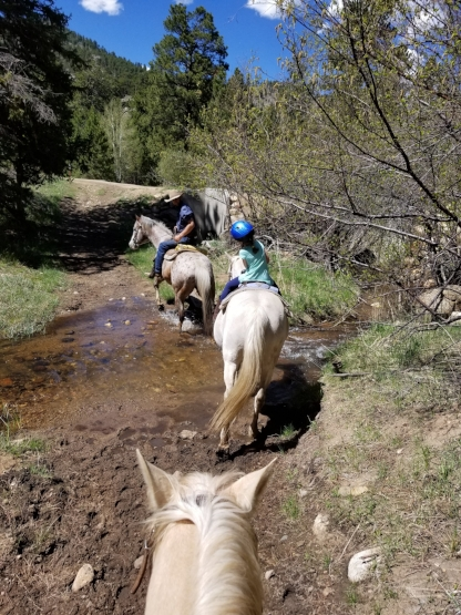 Day one: Crossing over the water on horseback with my little girl.
