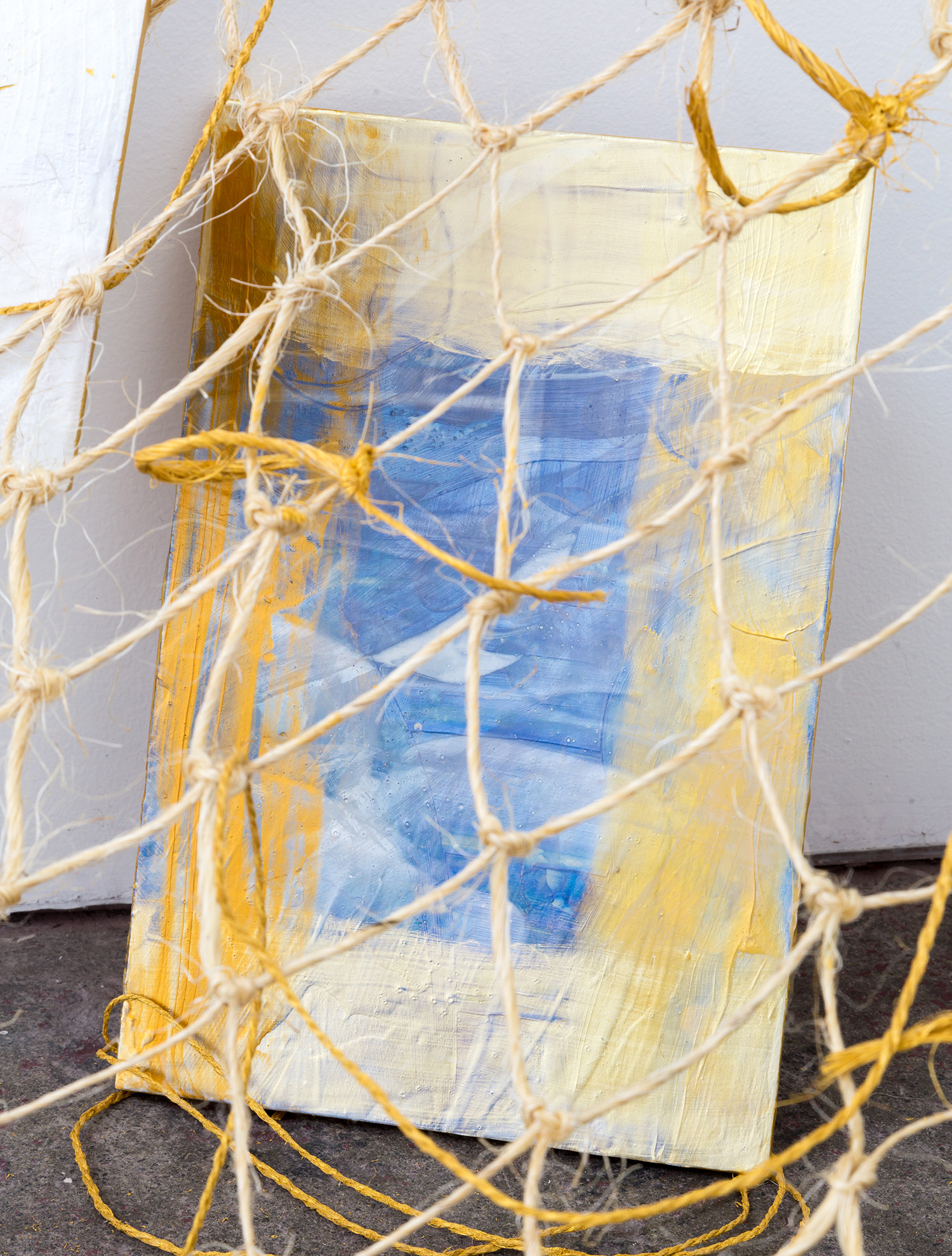 Il tient en main  (detail), 2018, acrylic on rope, twine, screws, glass and Japanese Magnolia, dimensions variable.  Image: André Piguet.